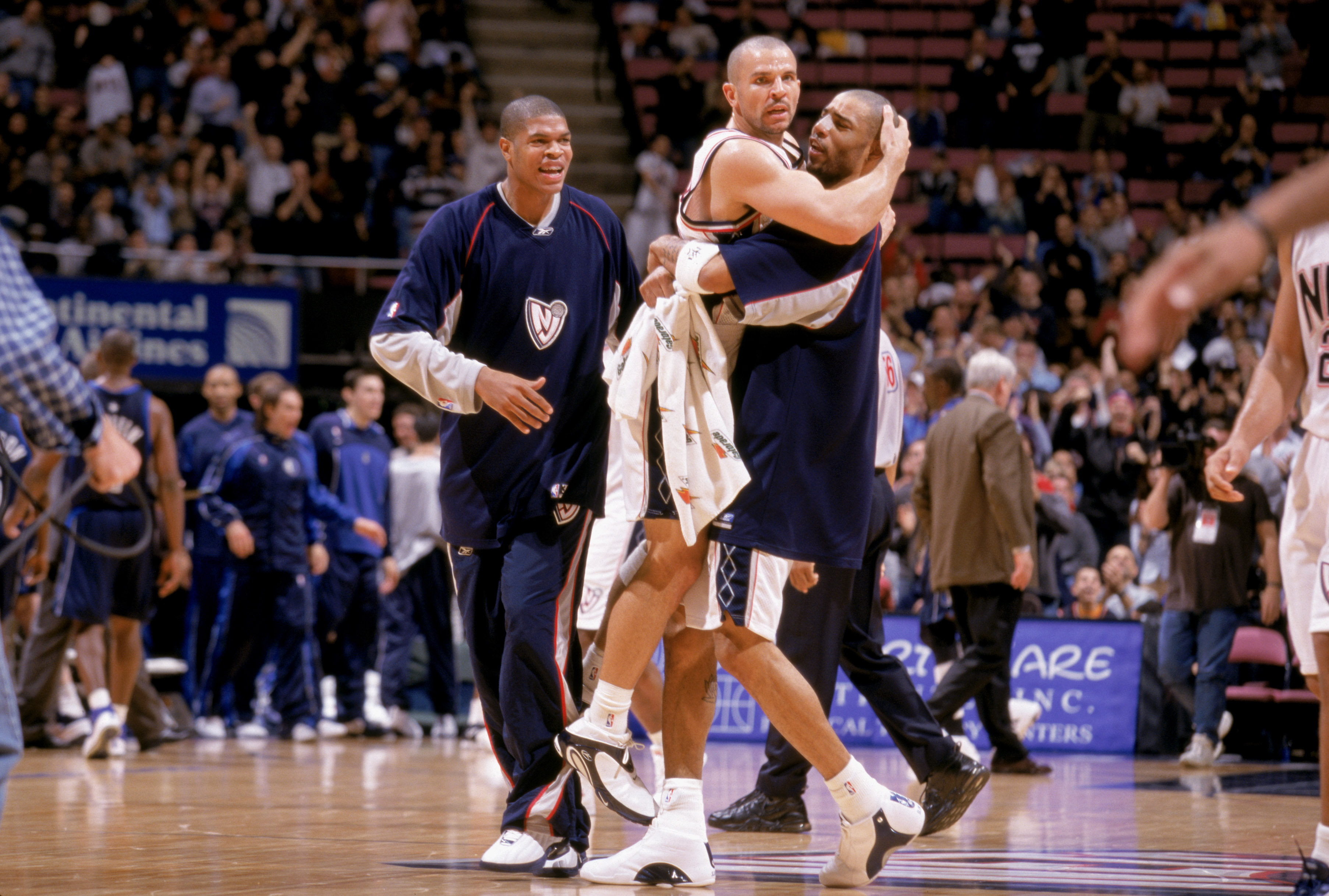 98578299d0d5 Jason Kidd  5 of the New Jersey Nets leaps into the arms of Kenyon Martin