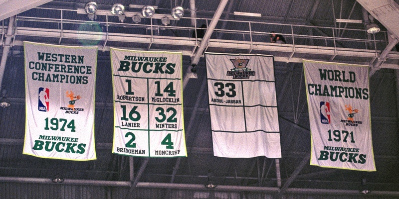 the players who wore retired numbers before they were