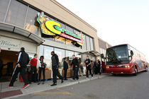 The team gets off the bus and gets ready to surprise shoppers at Cermak Fresh Ma