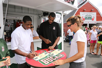 Brandon Knight and Khris Middleton sign autographs at Bucks Headquarters