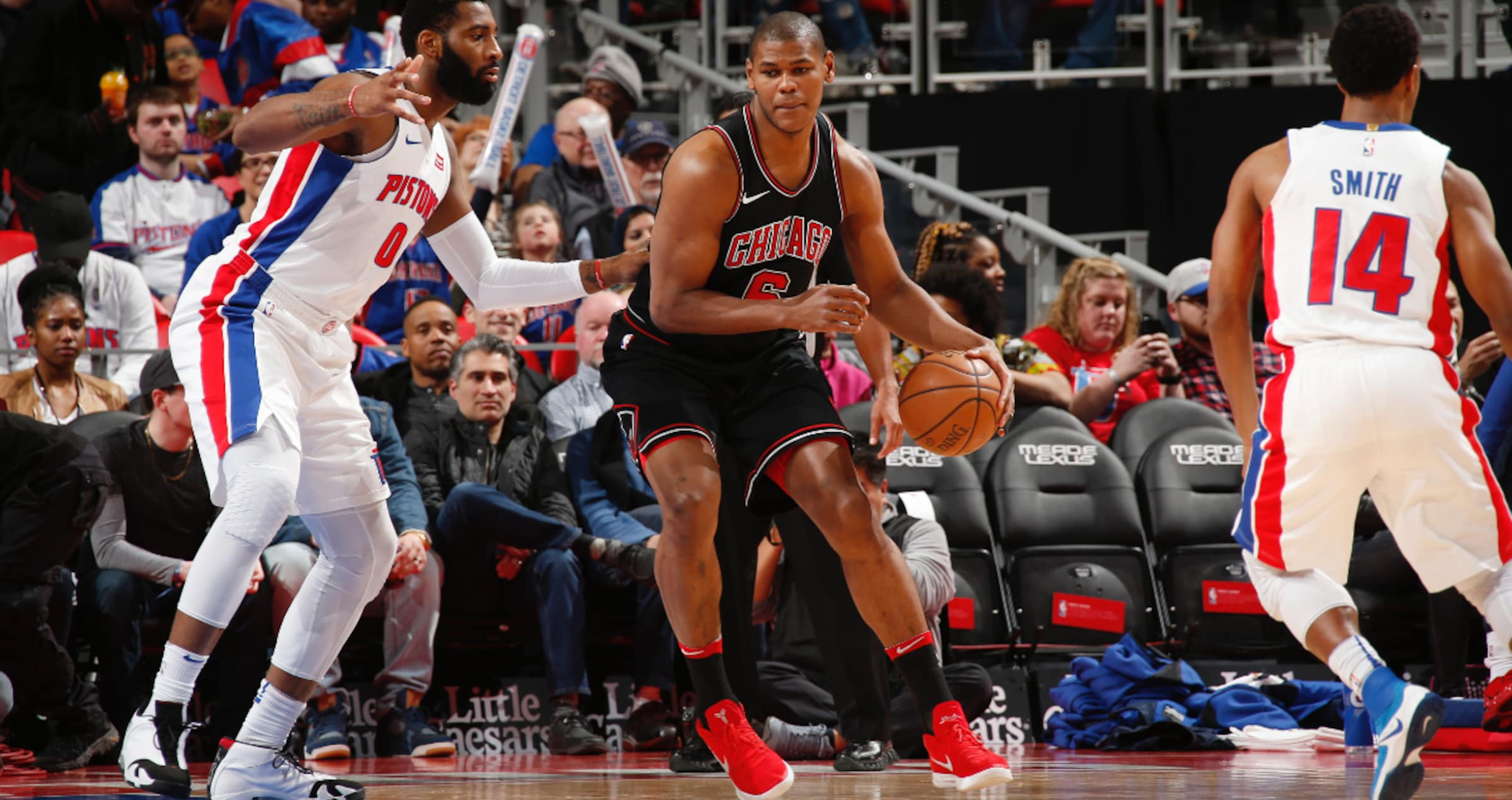 Cristiano Felicio posts up against Andre Drummond of the Detroit Pistons