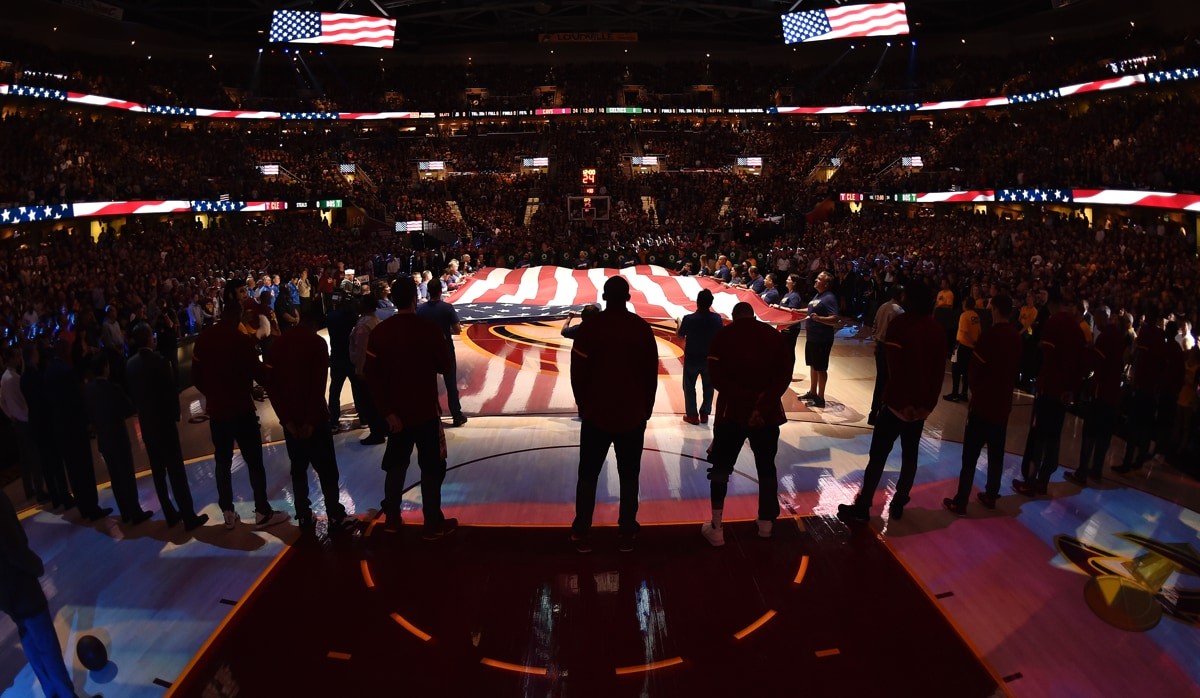 NBA players stand for the National Anthem