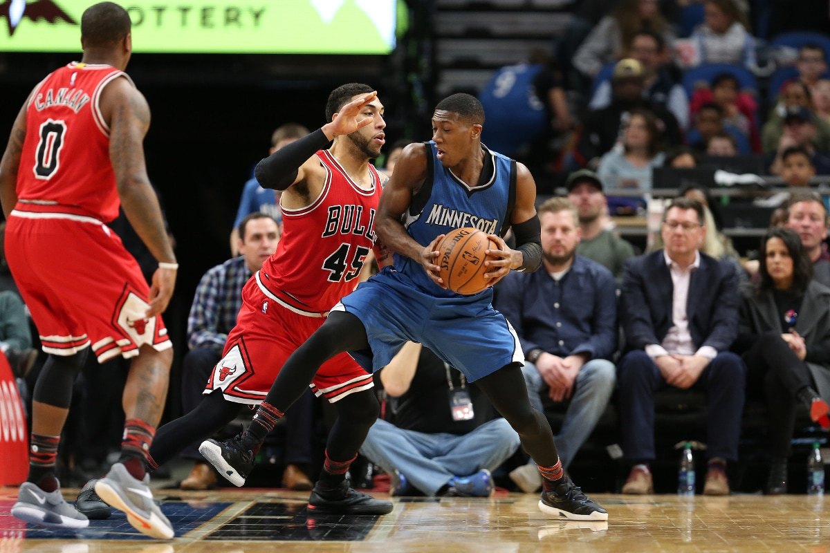 Kris Dunn playing for the Minnesota Timberwolves posting up against Denzel Valentine of the Chicago Bulls.