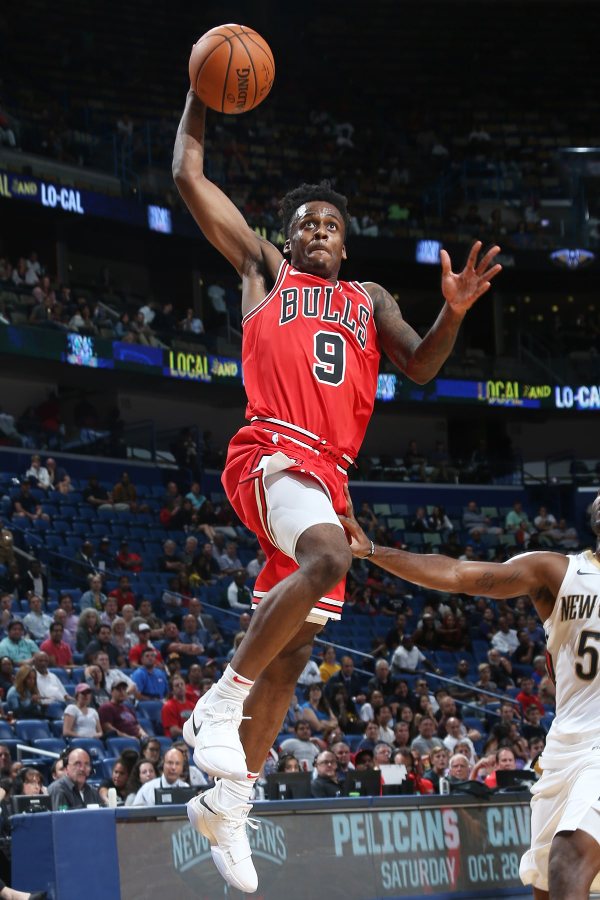 Antonio Blakeney #9 of the Chicago Bulls shoots the ball during a preseason game against the New Orleans Pelicans on October 3, 2017 at the Smoothie King Center in New Orleans, Louisiana.
