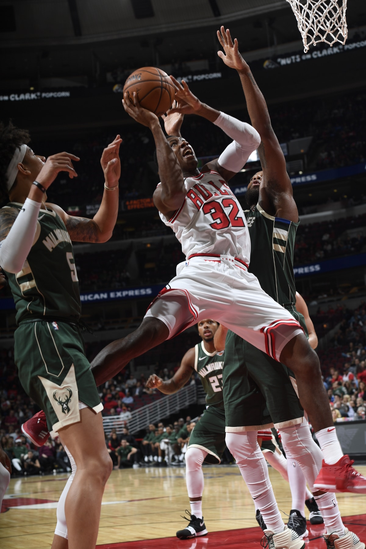 Kris Dunn of the Chicago Bulls attempting a layup against players of the Milwaukee Bucks, October 6, 2017 at the United Center.