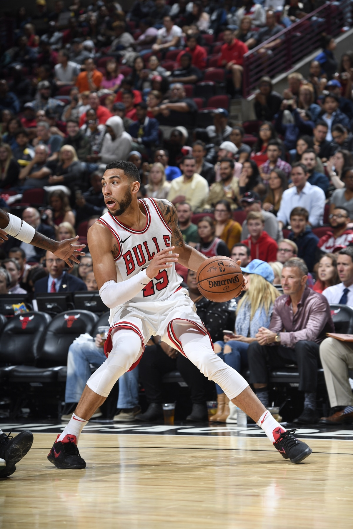 Denzel Valentine dribbling against players of the Milwaukee Bucks, October 6, 2017 at the United Center.