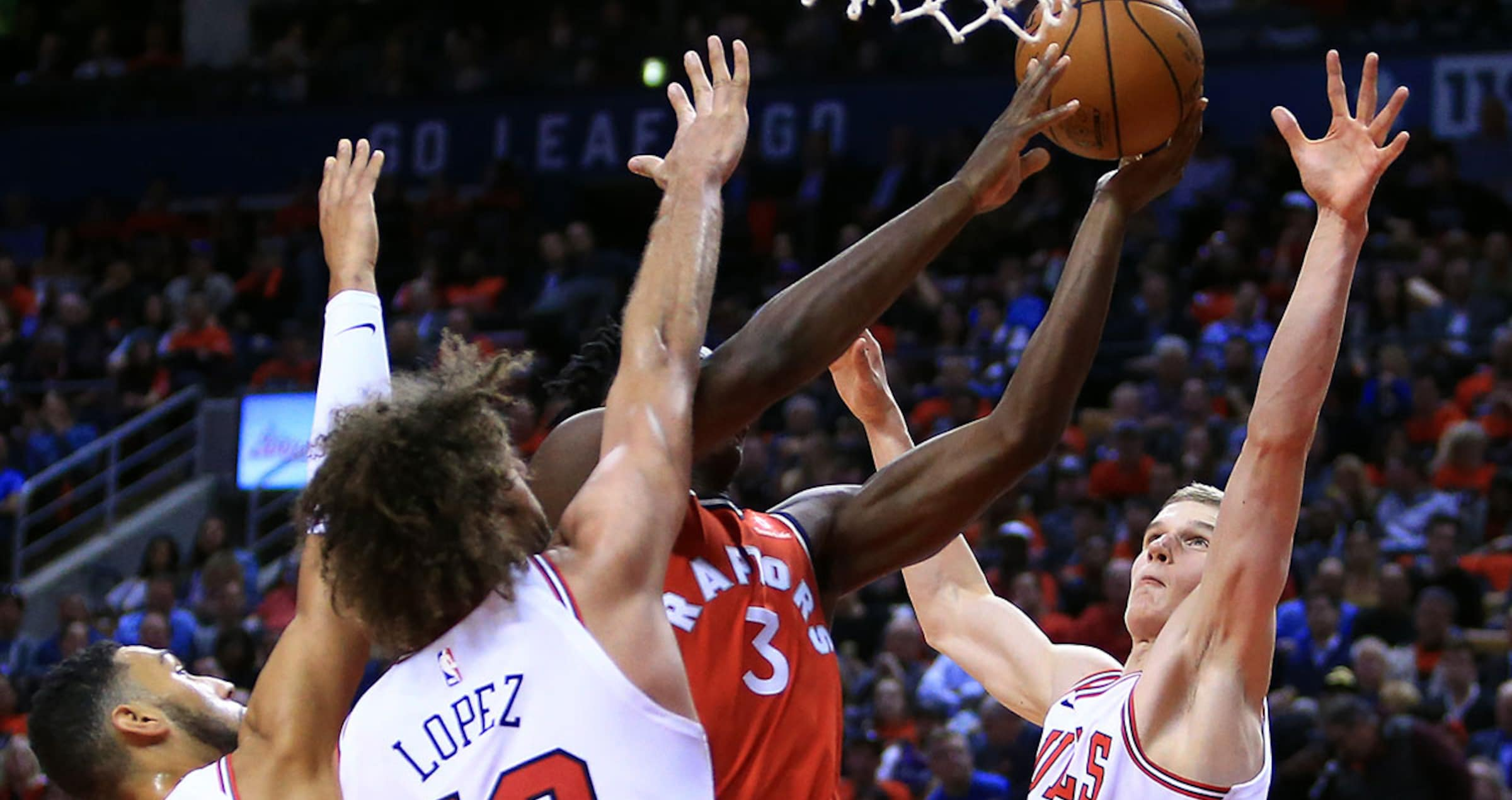 Lauri Markkanen #24 of the Chicago Bulls defends a shot by OG Anunoby #3 of the Toronto Raptors during the second half of an NBA game at Air Canada Centre on October 19, 2017 in Toronto, Canada.
