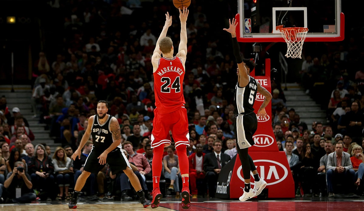 Lauri Markkanen #24 of the Chicago Bulls attempts a shot in the fourth quarter against the San Antonio Spurs at the United Center on October 21, 2017 in Chicago, Illinois.
