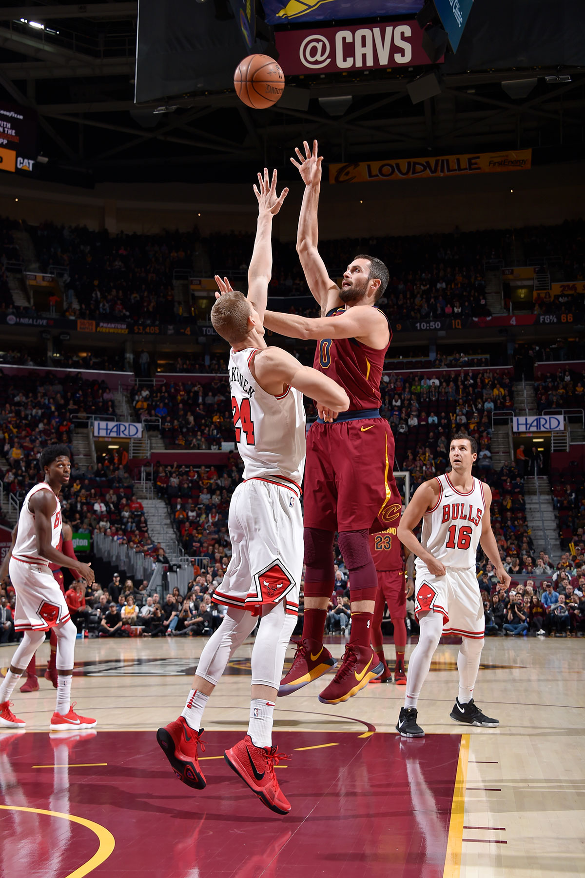 Lauri Markkanen #24 of the Chicago Bulls and Kevin Love #0 of the Cleveland Cavaliers tipoff at the beginning of the game on October 24, 2017 at Quicken Loans Arena in Cleveland, Ohio.