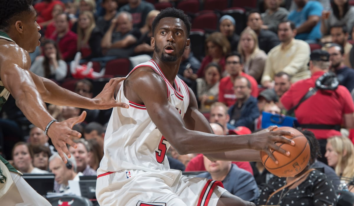 Bobby Portis looks to pass the ball against Milwaukee