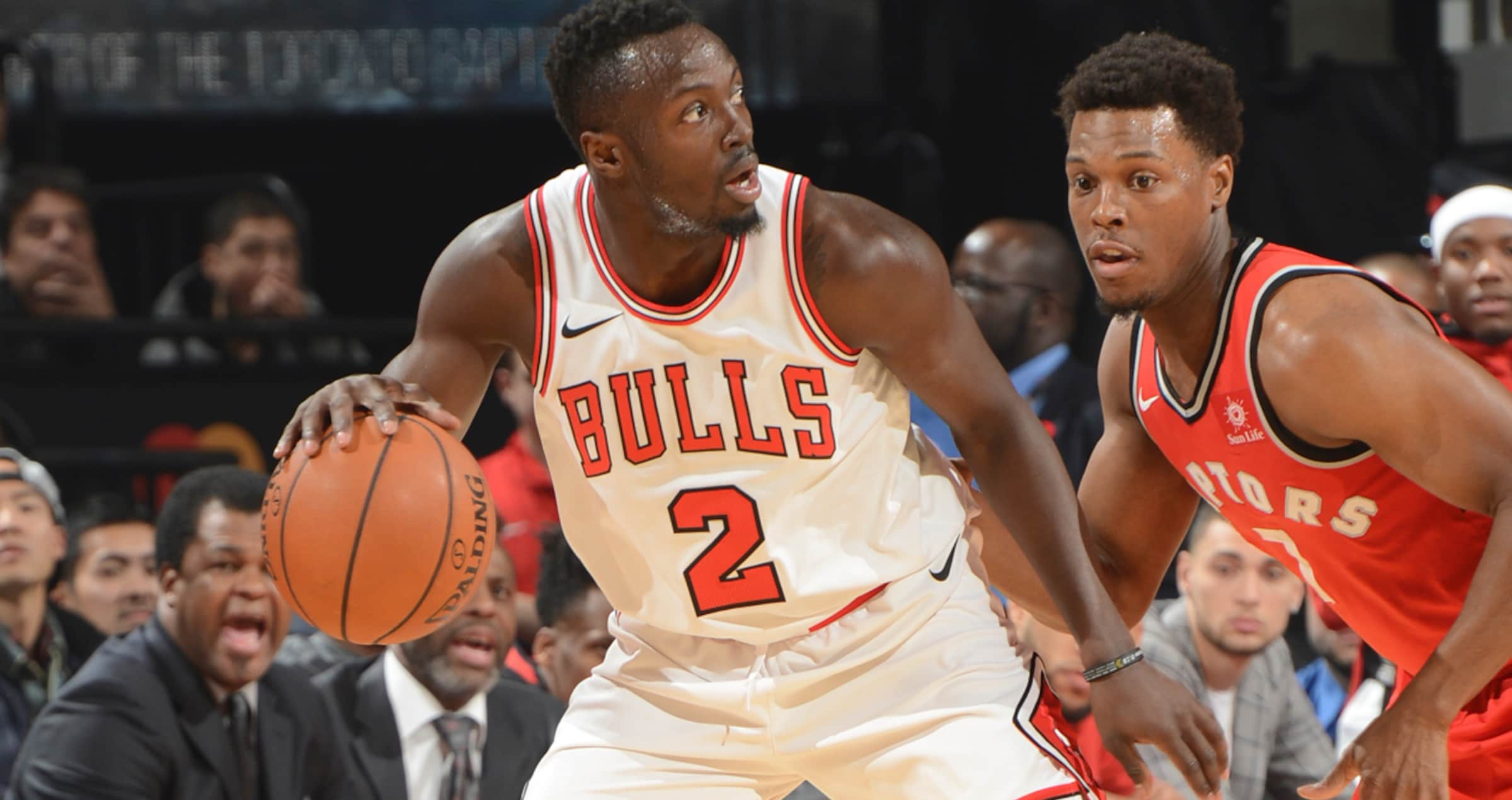 Jerian Grant is guarded by Kyle Lowry of the Toronto Raptors