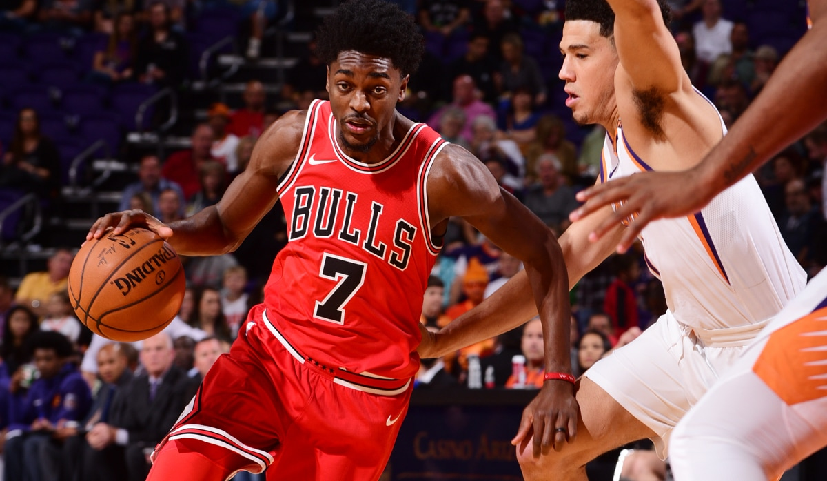 13d98a2a739 Justin Holiday #7 of the Chicago Bulls handles the ball against Devin Booker  #1