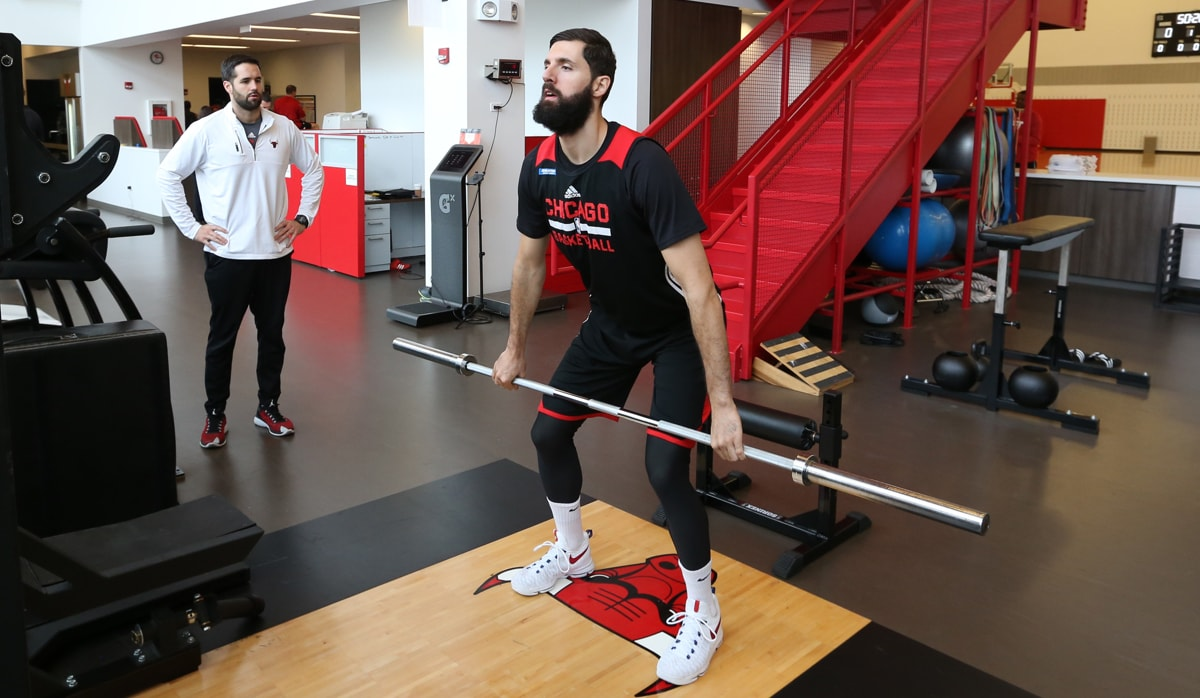 Nikola Mirotic #44 of the Chicago Bulls lift weights during the Chicago Bulls All Access practice on October 11, 2016 at the Advocate Center in Chicago, Illinois.