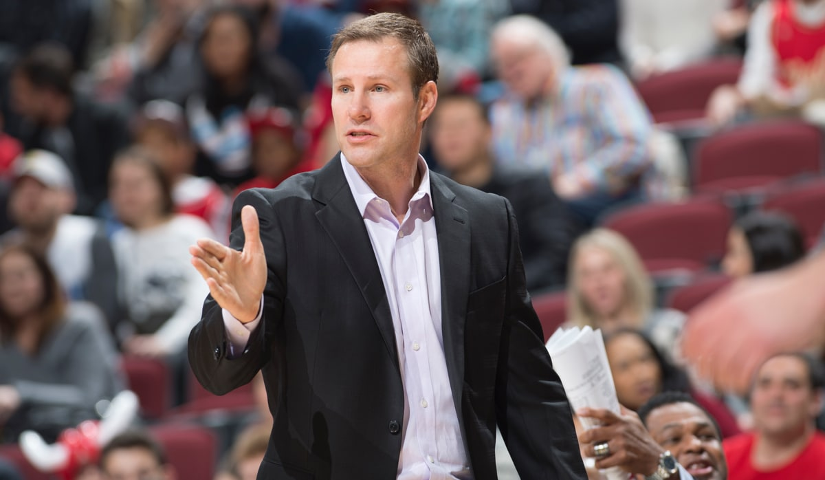 Fred Hoiberg coaching from the sidelines