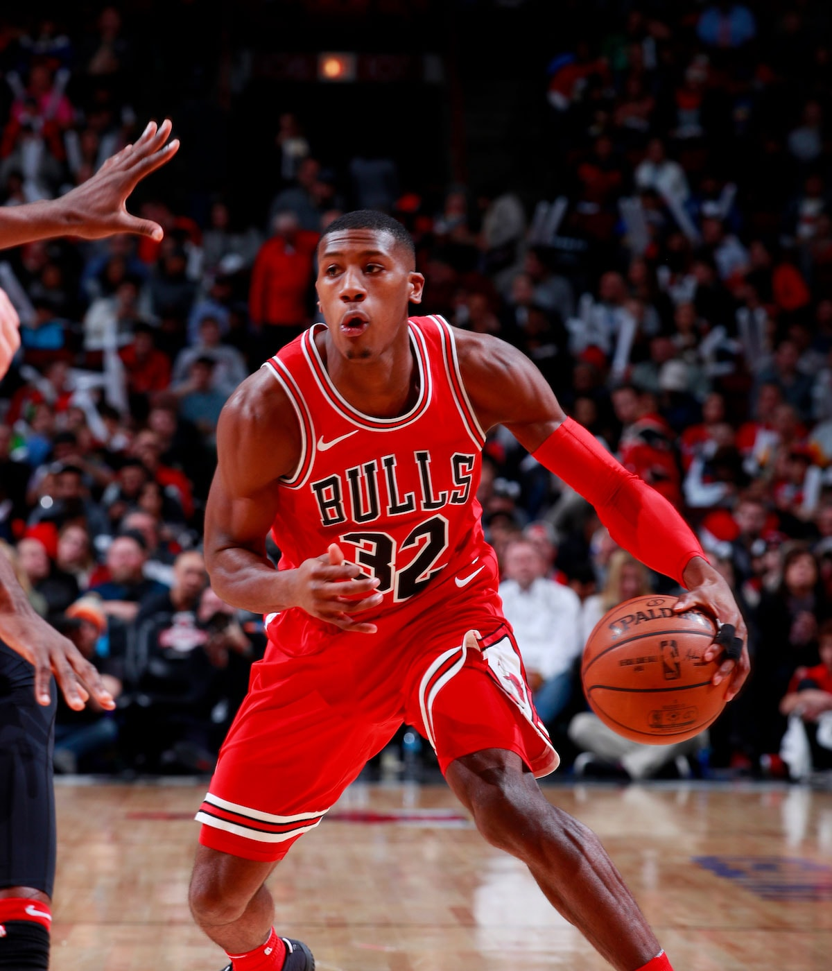 Kris Dunn handles the ball.