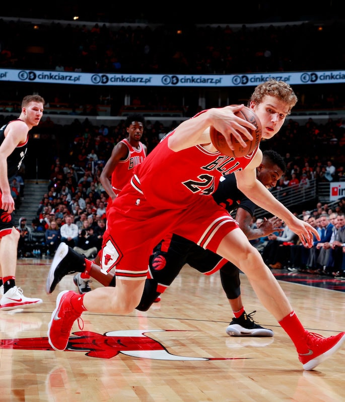 Markkanen handles the ball.