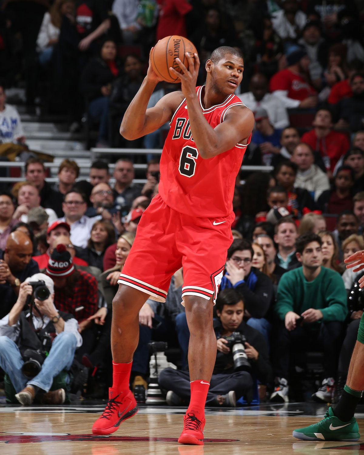 Cristiano Felicio handles the ball.