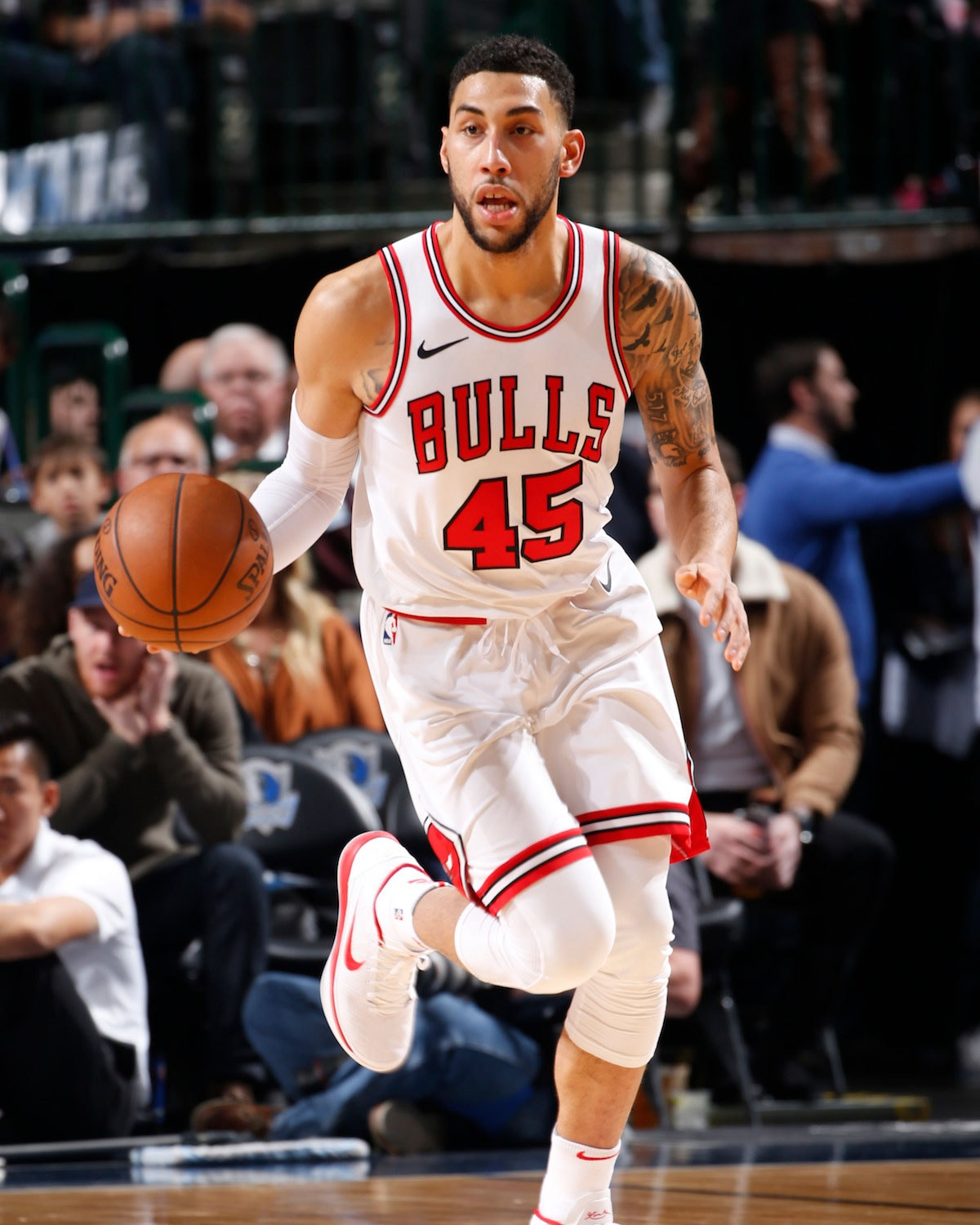 Denzel Valentine dribbles the ball.
