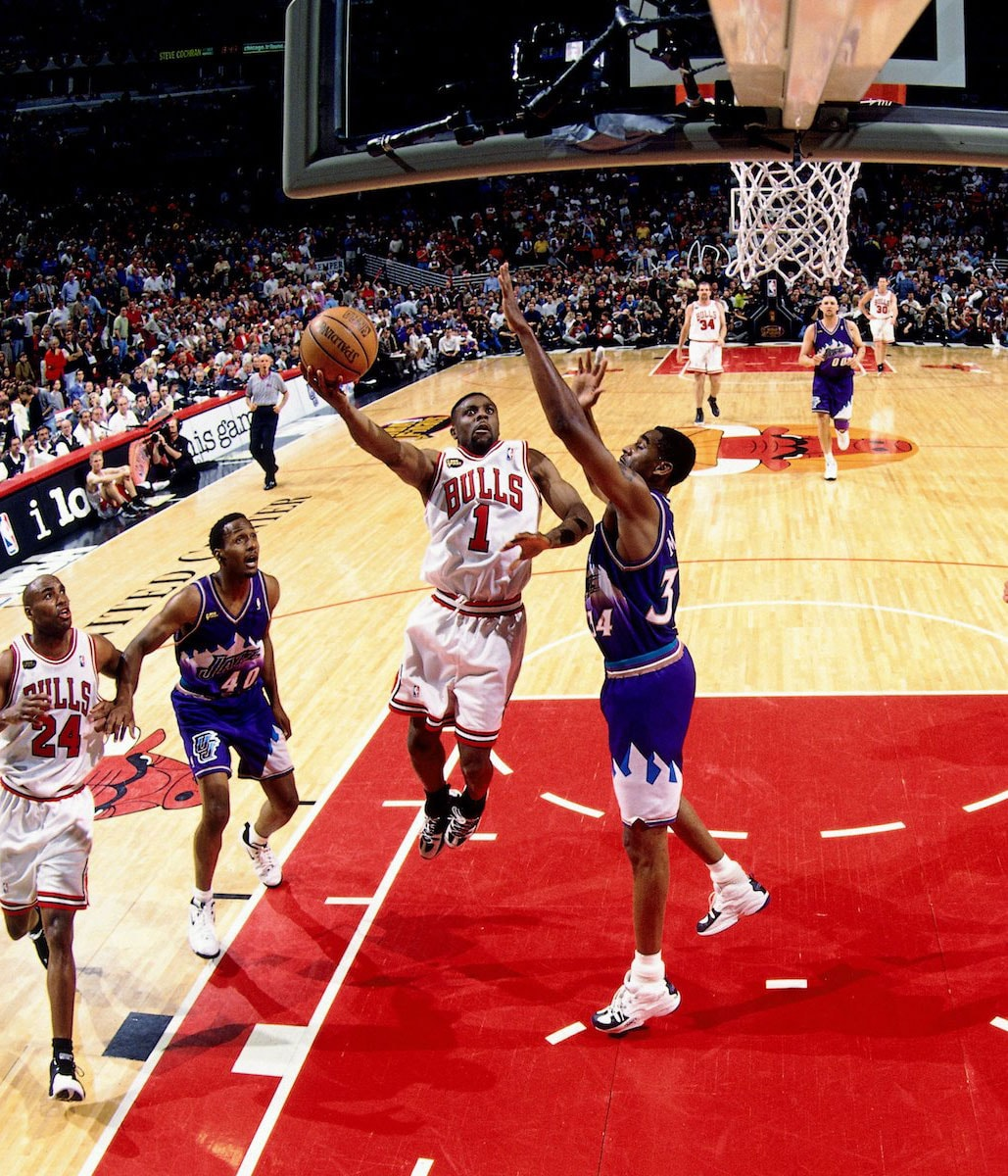 Randy Brown #1 of the Chicago Bulls attempts a layup against Chris Morris #34 of the Utah Jazz in Game Three of the 1998 NBA Finals at the United Center on June 5, 1998 in Chicago, Illinois