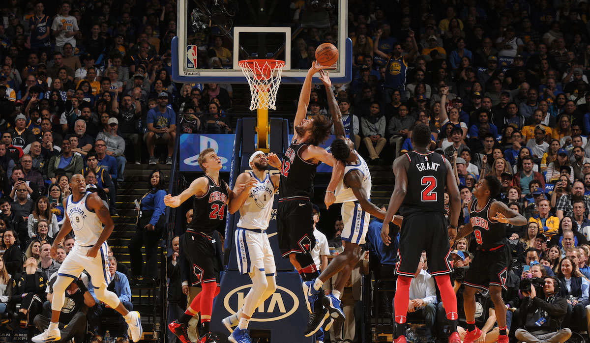 Robin Lopez #42 of the Chicago Bulls goes up for a rebound against Jordan Bell #2 of the Golden State Warriors on November 24, 2017 at ORACLE Arena in Oakland, California.