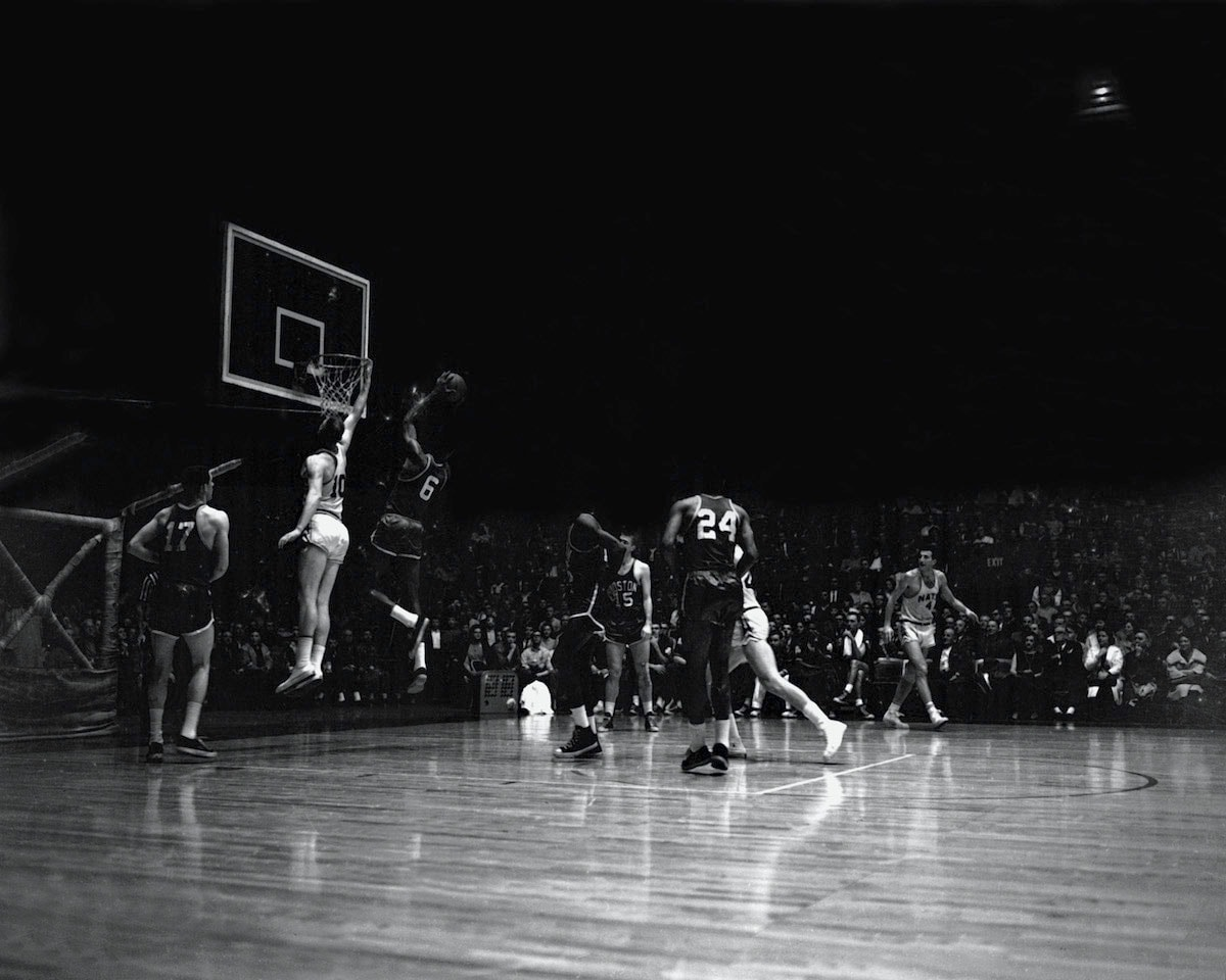 Bill Russell #6 of the Boston Celtics shoots against Red Kerr #10 of the Syracuse Nationals circa 1960 at the Onondaga War Memorial Arena in Syracuse, New York.