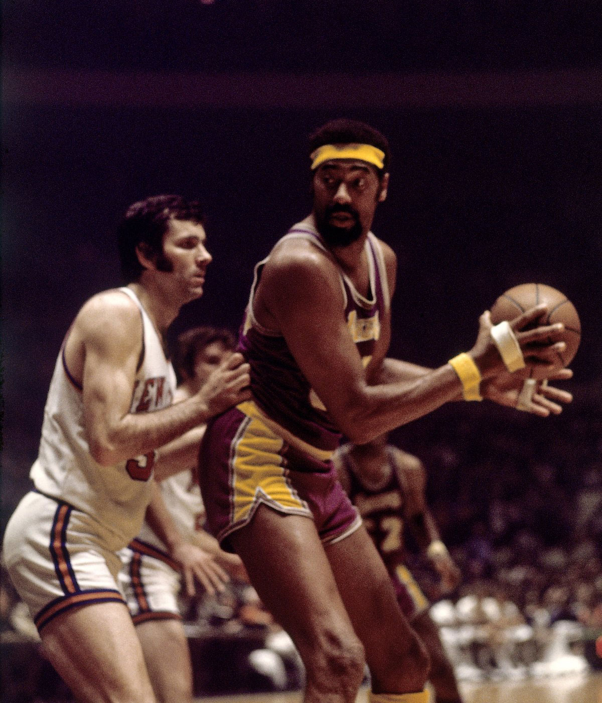 Wilt Chamberlain #13 of the Los Angeles Lakers posts up against the New York Knicks during a game played in 1972 at Madison Square Garden in New York, New York.