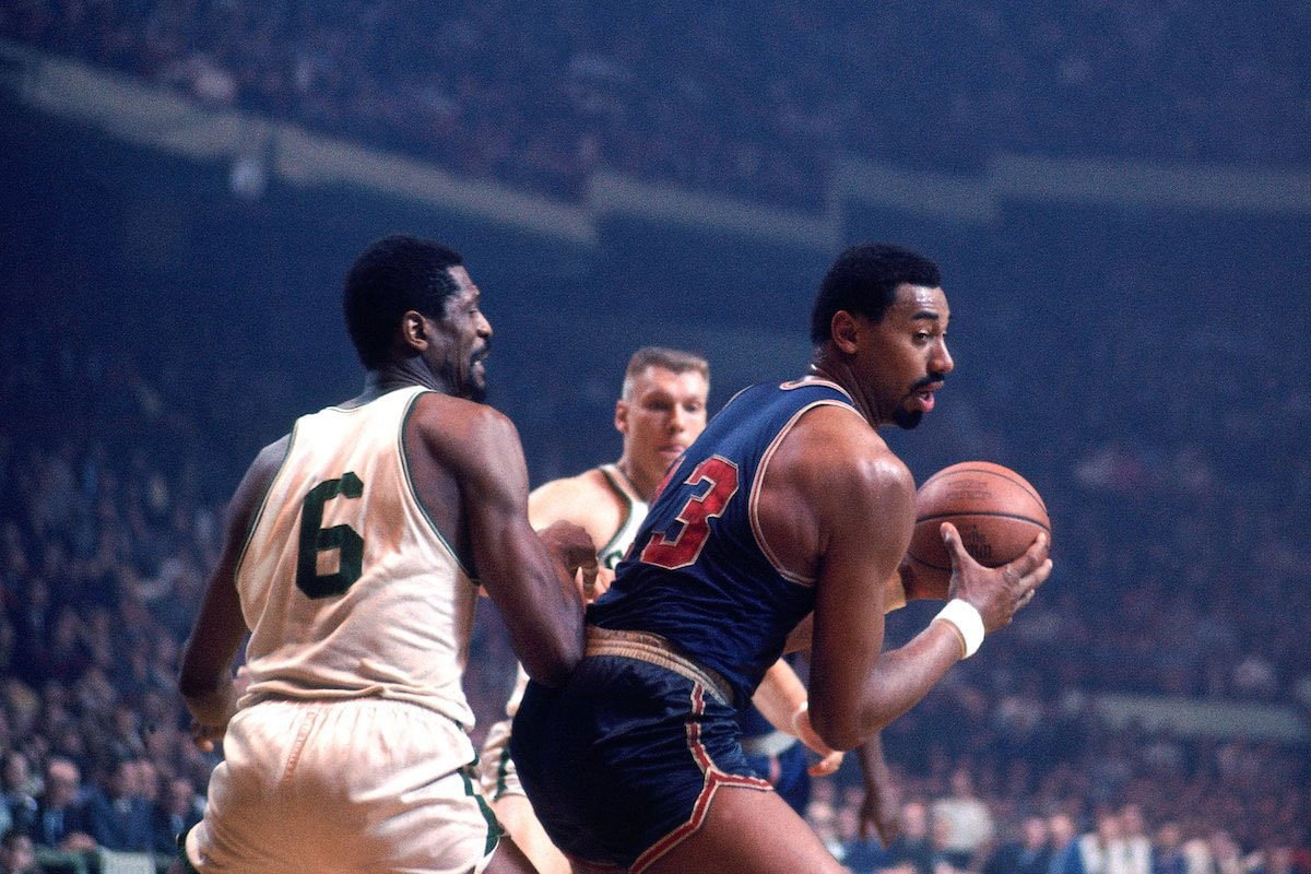 Wilt Chamberlain #13 of the Philadelphia 76ers posts up against Bill Russell #6 of the Boston Celtics during a game played in 1967 at the Boston Garden in Boston, Massachusetts.