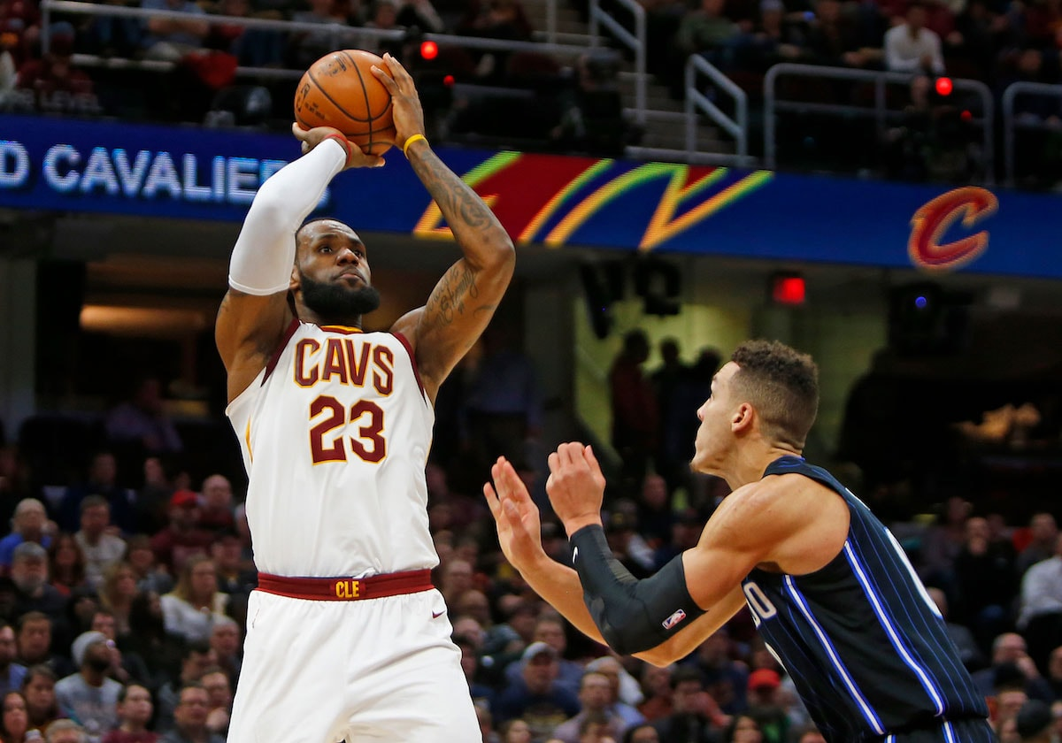 LeBron James #23 of the Cleveland Cavaliers pulls up for a shot against Aaron Gordon #00 of the Orlando Magic at Quicken Loans Arena on January 18, 2018 in Cleveland, Ohio.