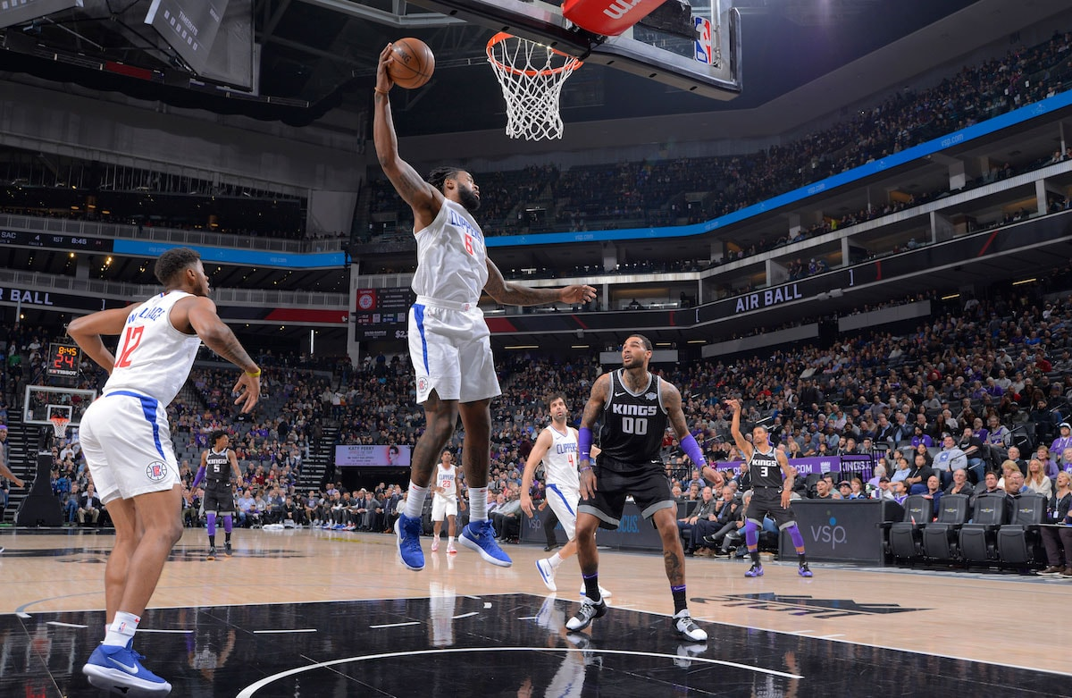 DeAndre Jordan #6 of the Los Angeles Clippers rebounds against the Sacramento Kings on January 11, 2018 at Golden 1 Center in Sacramento, California.