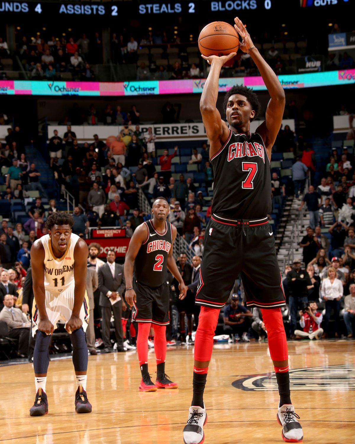 Justin Holiday #7 of the Chicago Bulls shoots a free throw at the the Smoothie King Center in New Orleans, Louisiana.