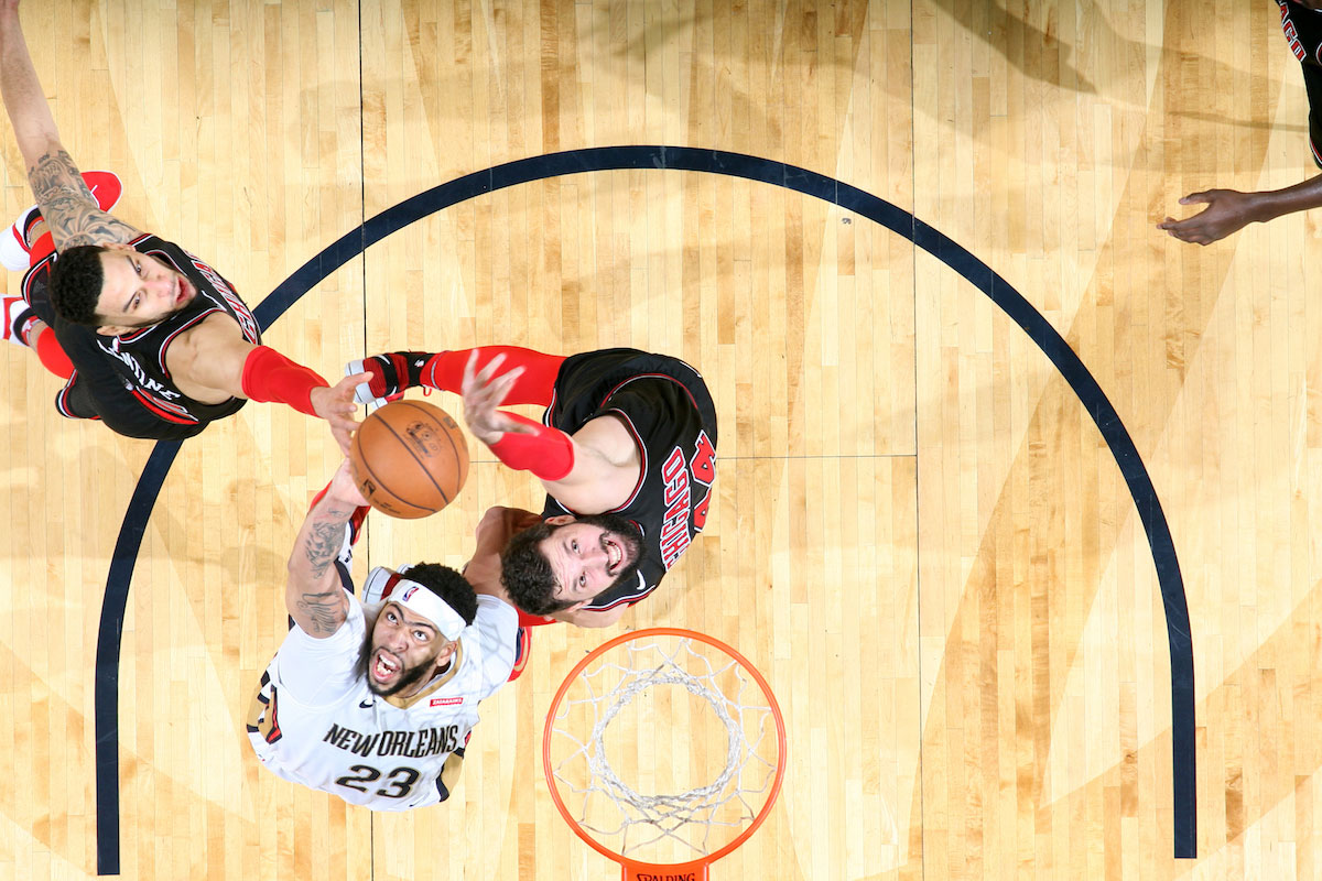 Anthony Davis #23 of the New Orleans Pelicans and Nikola Mirotic #44 of the Chicago Bulls jump for the rebound