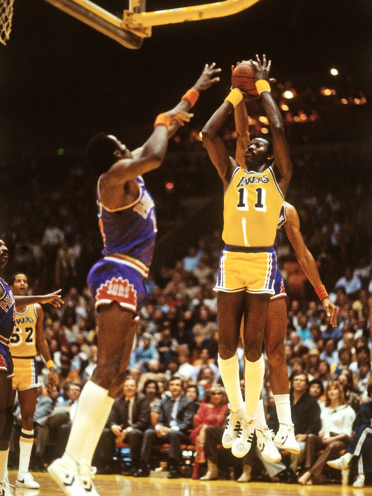 Bob McAdoo #11 of the Los Angeles Lakers shoots the ball against the Phoenix Suns during a game circa 1988 at The Forum in Los Angeles, California.