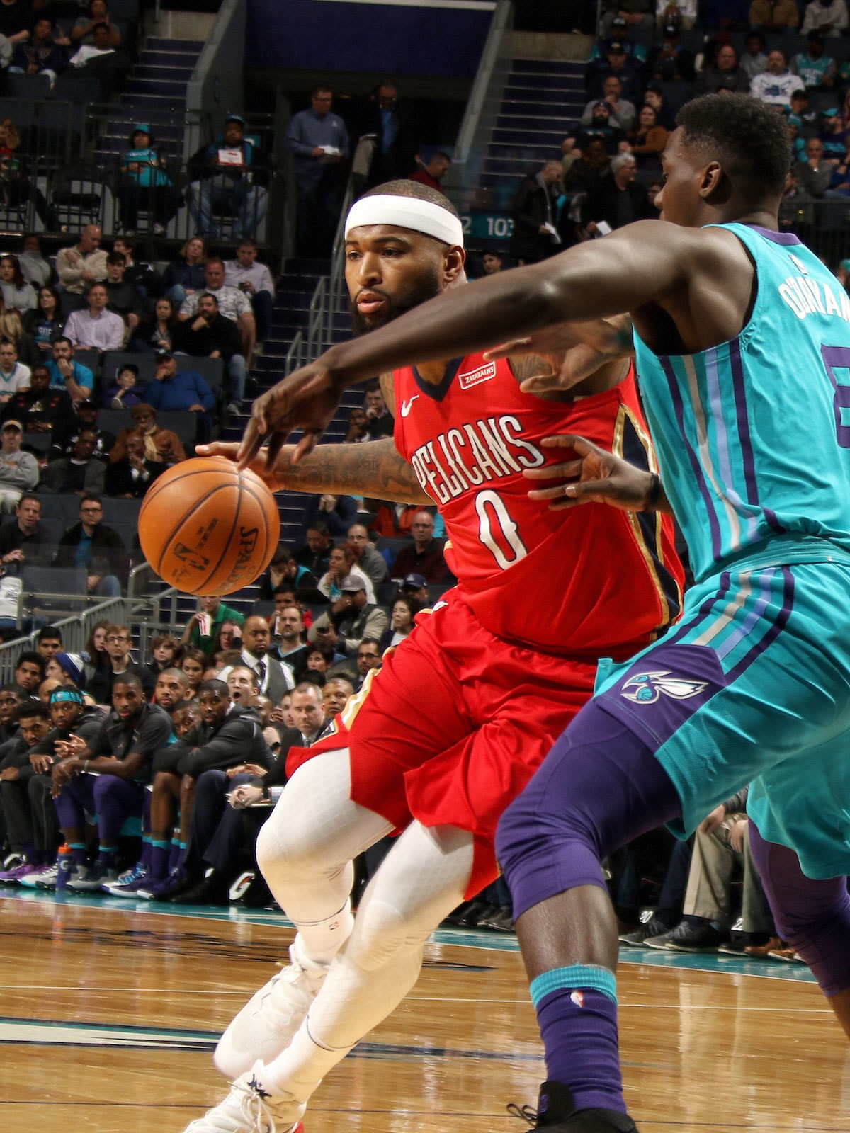 DeMarcus Cousins #0 of the New Orleans Pelicans handles the ball against the Charlotte Hornets on January 24, 2018 at Spectrum Center in Charlotte, North Carolina.