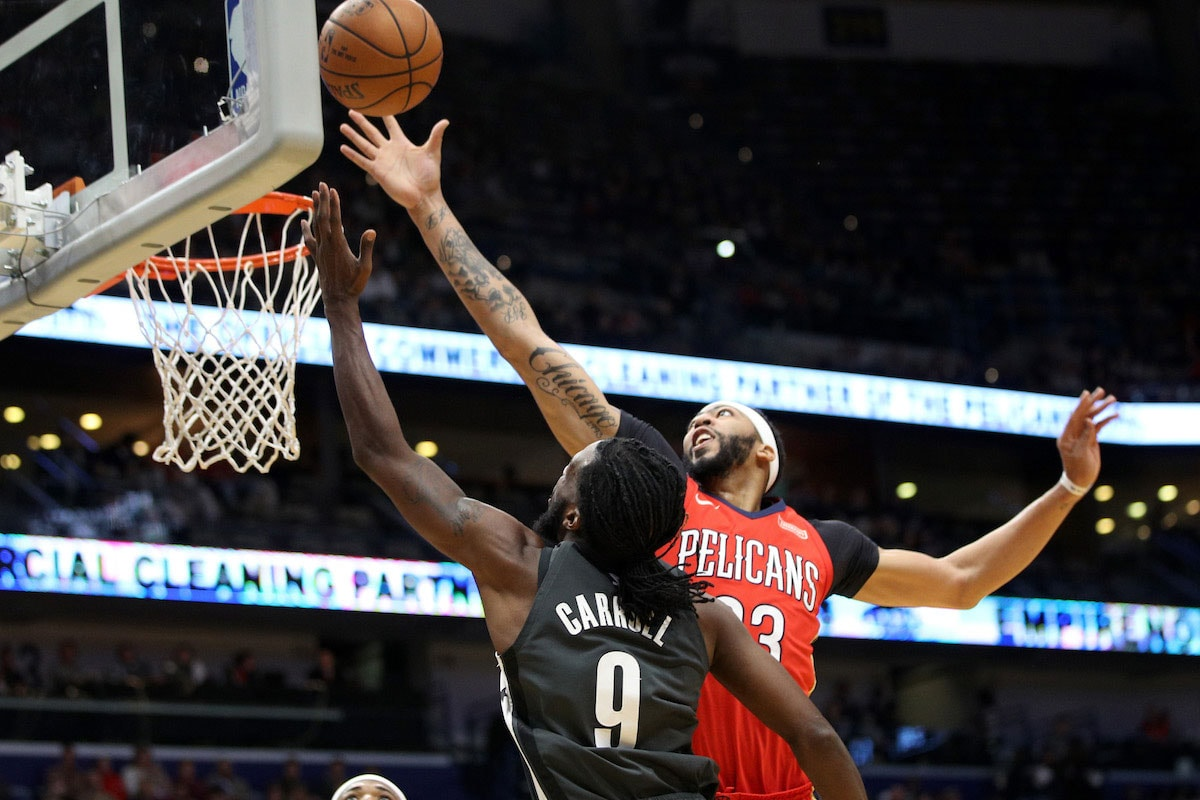 DeMarre Carroll #9 of the Brooklyn Nets shoots the ball over Anthony Davis #23 of the New Orleans Pelicans at the Smoothie King Center on December 27, 2017 in New Orleans, Louisiana.