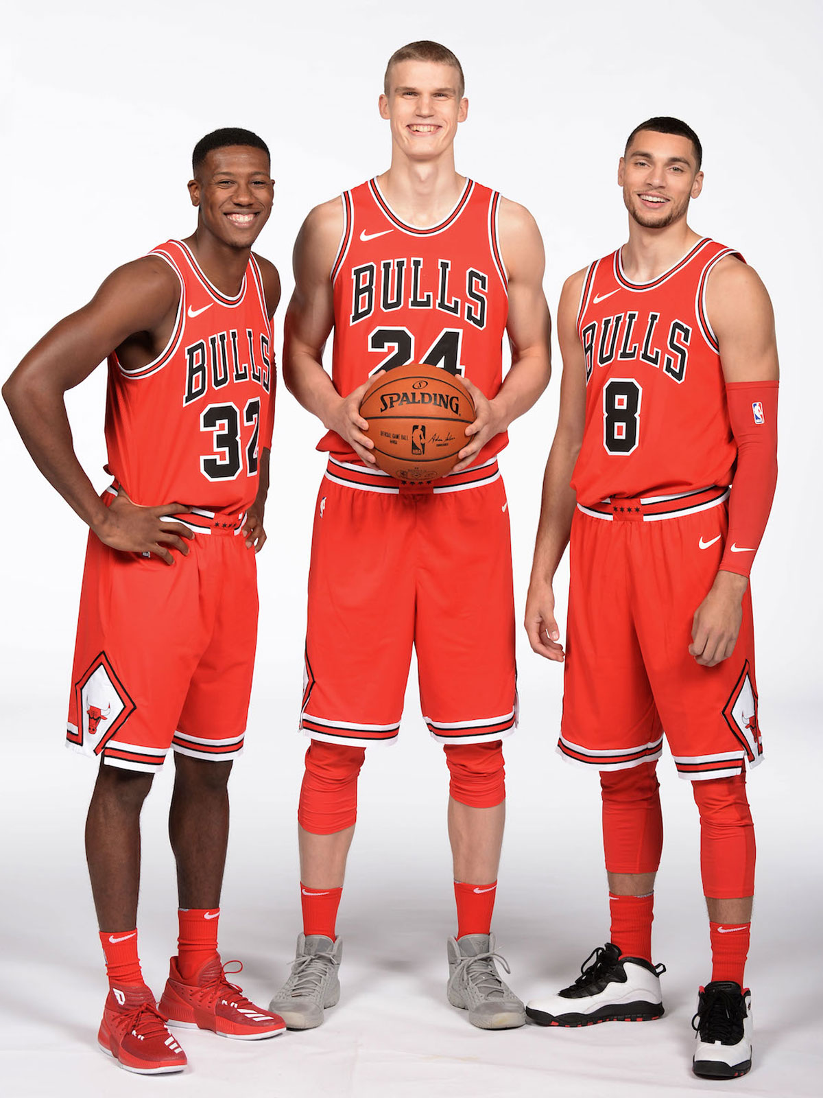 Kris Dunn #32, Lauri Markkanen #24 and Zach LaVine #8 of the Chicago Bulls poses for a portrait during the 2017-18 NBA Media Day on September 25, 2017 at the United Center in Chicago, Illinois