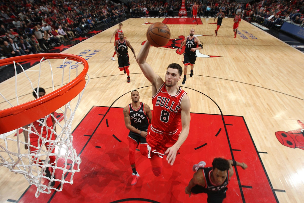 Zach LaVine #8 of the Chicago Bulls dunks the ball against the Toronto Raptors on February 14, 2018 at the United Center in Chicago, Illinois.