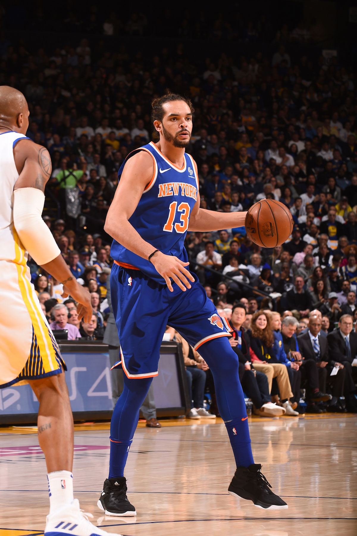 Joakim Noah #13 of the New York Knicks handles the ball against the Golden State Warriors on January 23, 2018 at ORACLE Arena in Oakland, California.
