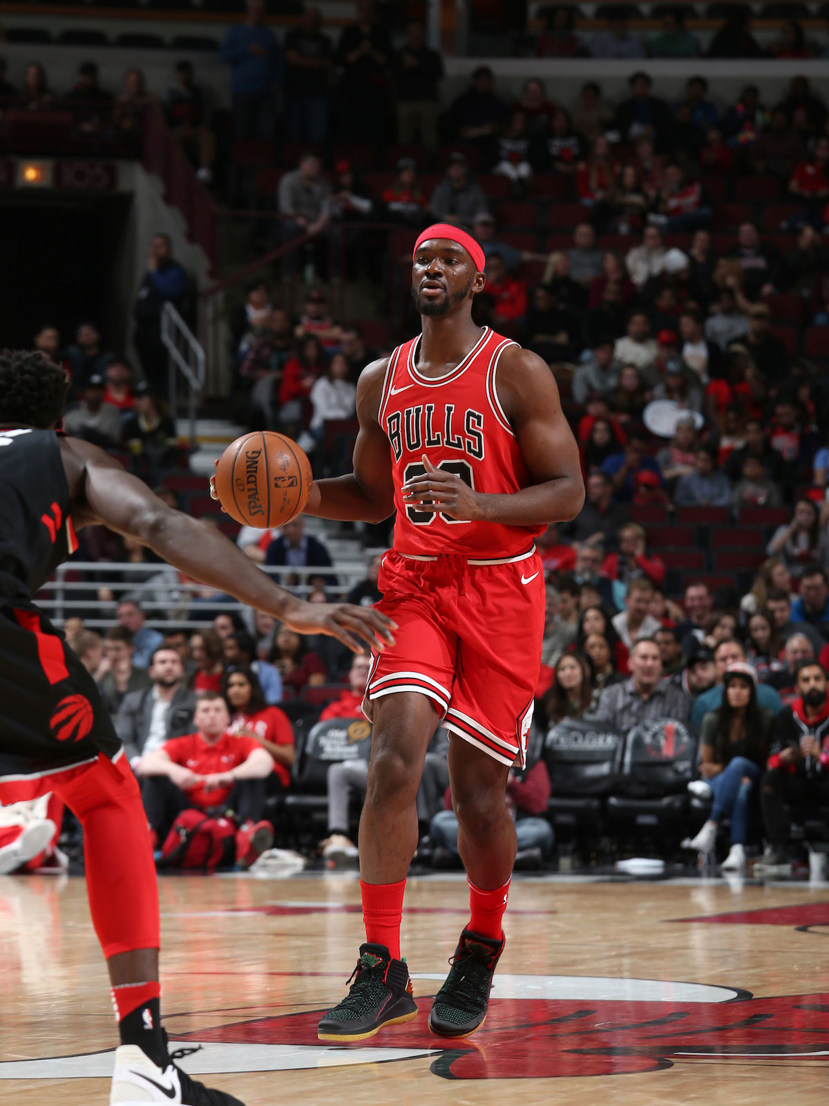 Noah Vonleh #30 of the Chicago Bulls handles the ball against the Toronto Raptors on February 14, 2018 at the United Center in Chicago, Illinois.