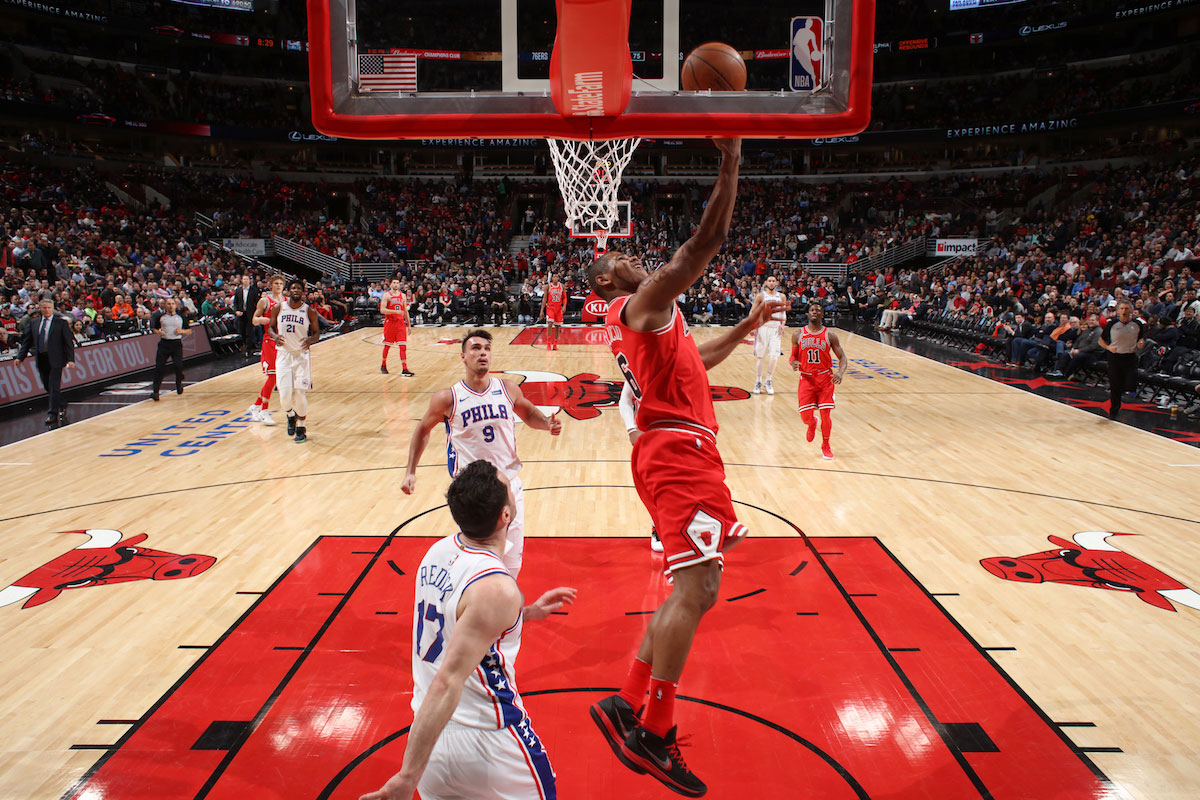 Cristiano Felicio #6 of the Chicago Bulls dunks against the Philadelphia 76ers on February 22, 2018 at the United Center in Chicago, Illinois