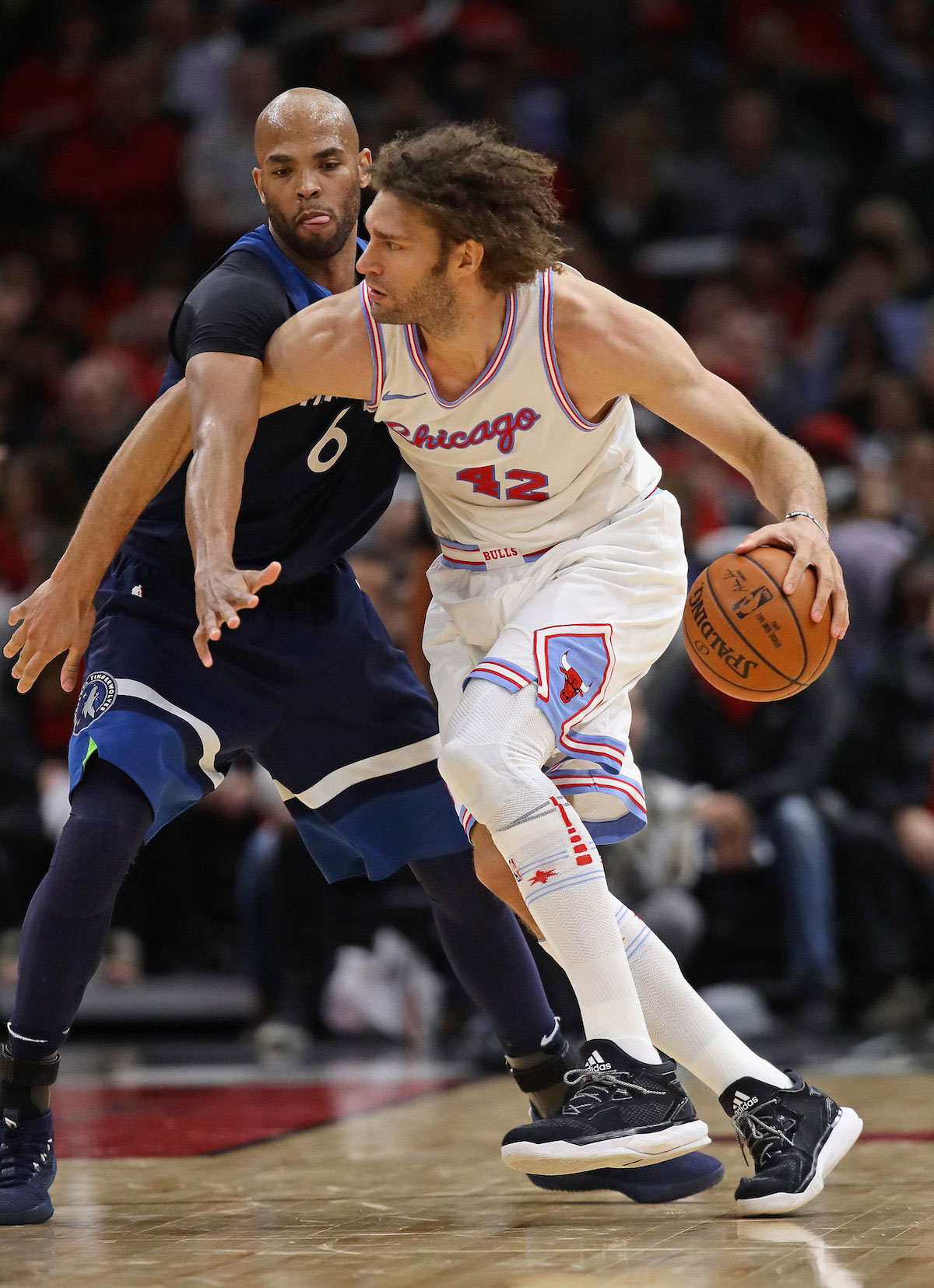 Robin Lopez #42 of the Chicago Bulls moves against Taj Gibson #67 of the Minnesota Timberwolves at the United Center on February 9, 2018 in Chicago, Illinois.