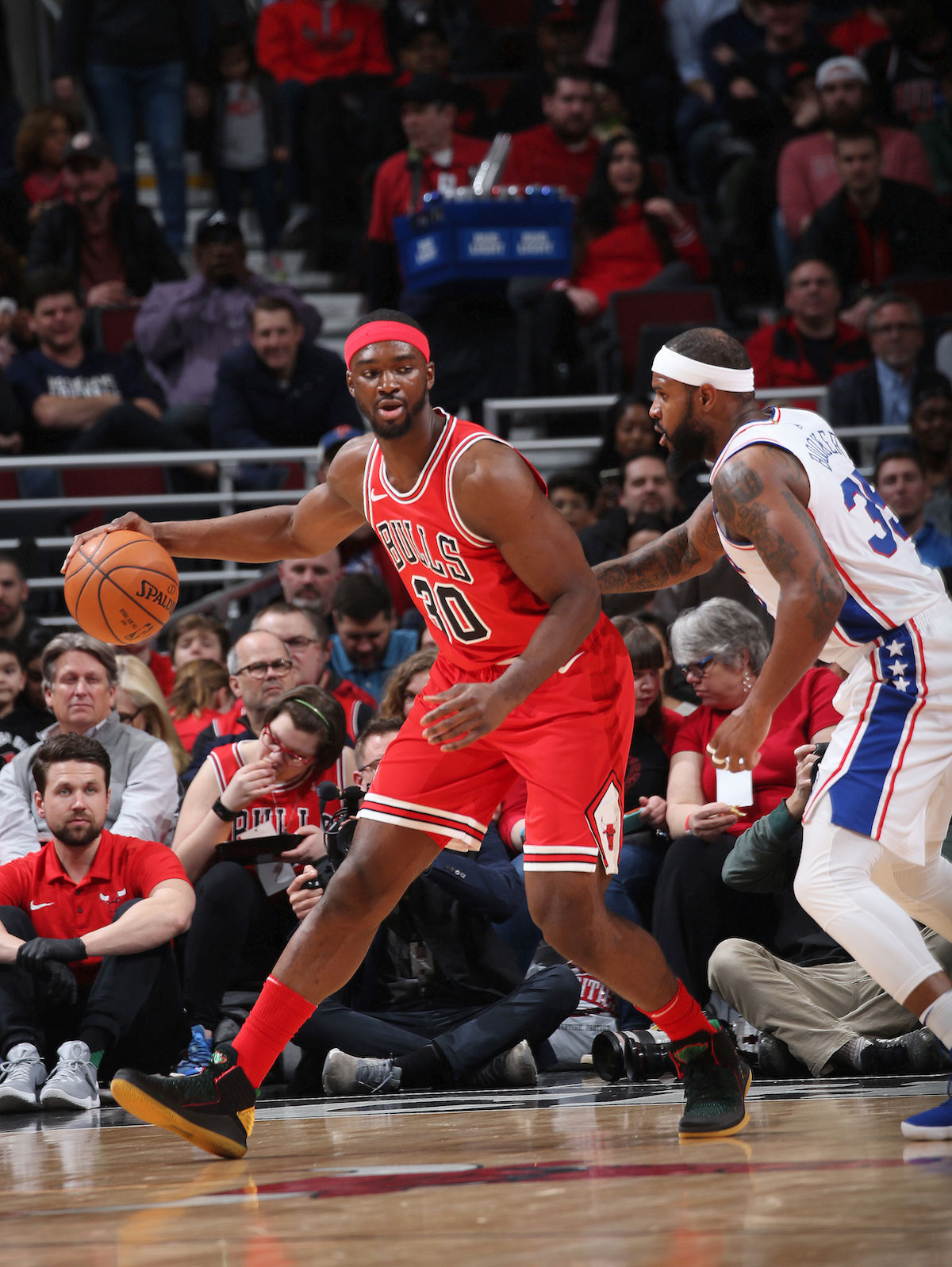 Noah Vonleh #30 of the Chicago Bulls handles the ball against the Philadelphia 76ers on February 22, 2018 at the United Center in Chicago, Illinois.