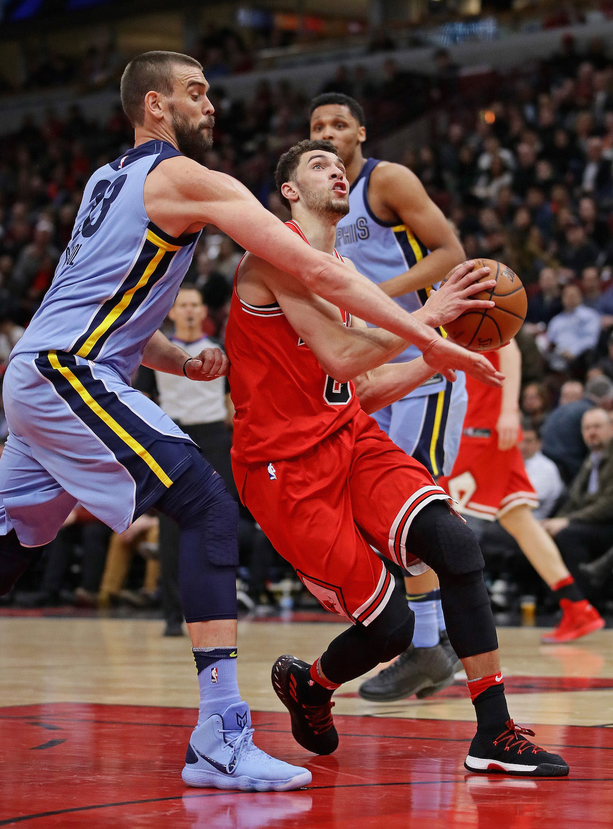 Zach LaVine #8 of the Chicago Bulls drives against Marc Gasol #33 of the Memphis Grizzlies