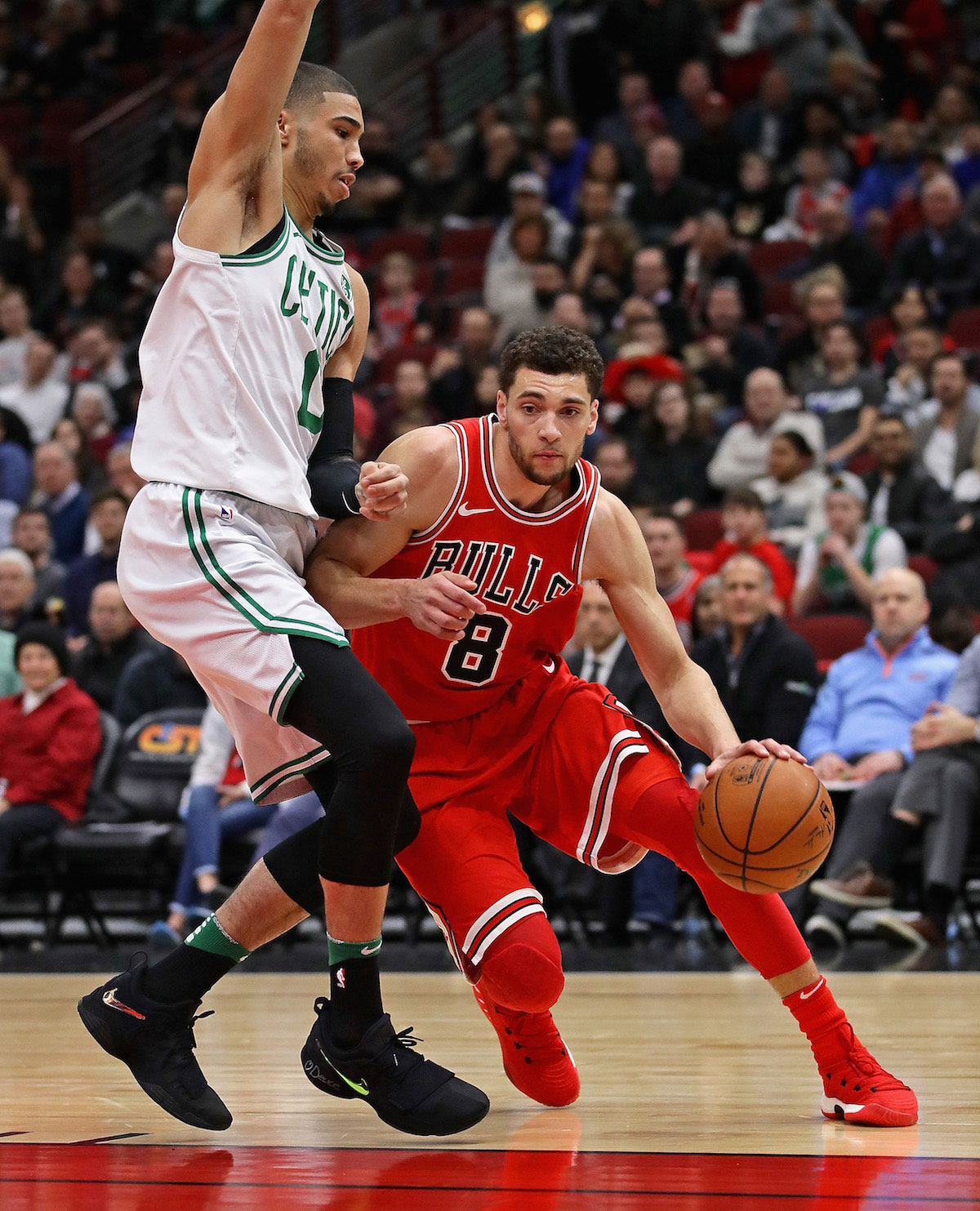 Zach LaVine #8 of the Chicago Bulls drives against Jayson Tatum #0 of the Boston Celtics at the United Center on March 5, 2018 in Chicago, Illinois