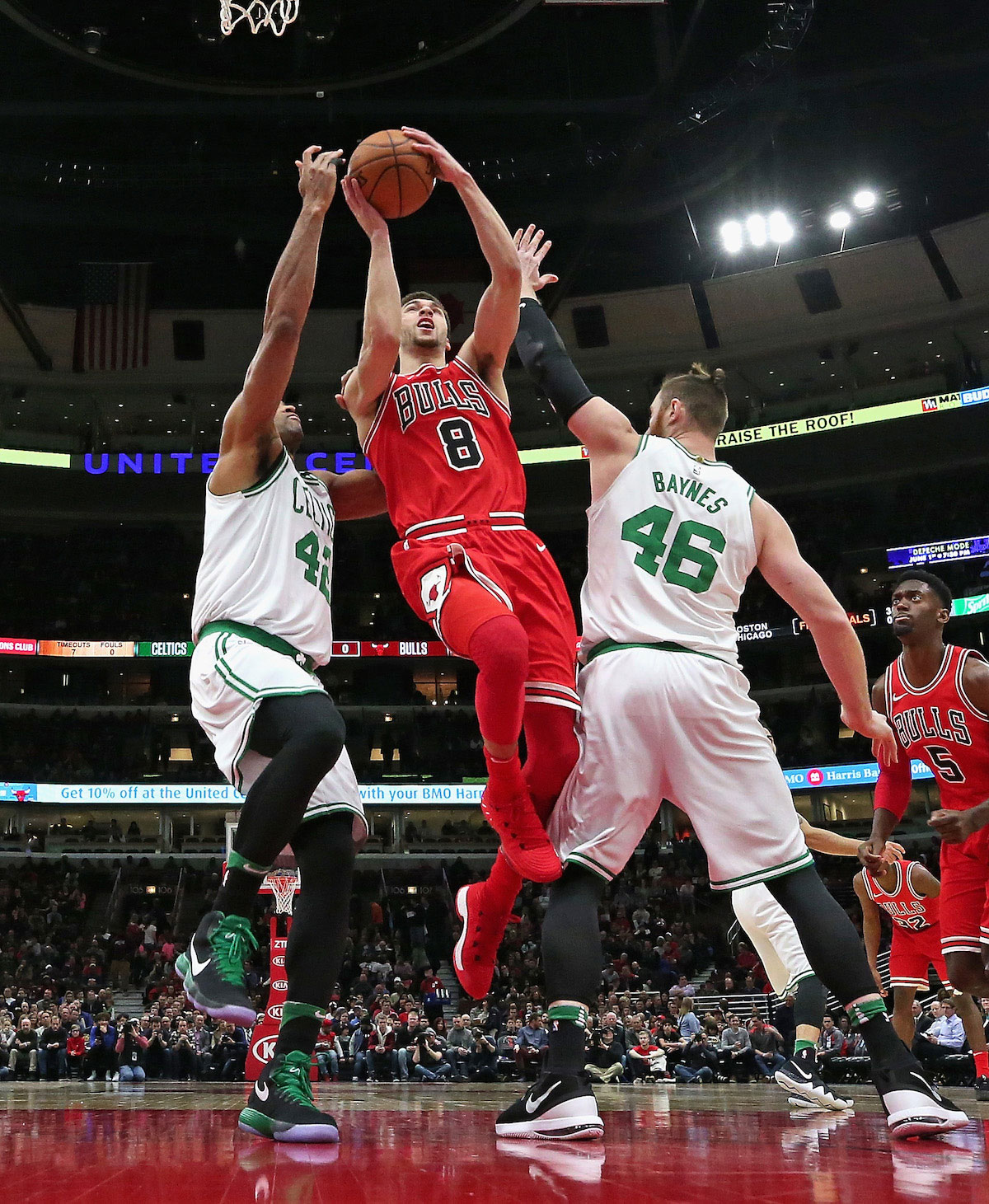 Zach LaVine #8 of the Chicago Bulls goes up for a shot between Al Horford #42 and Aron Baynes #46 of the Boston Celtics