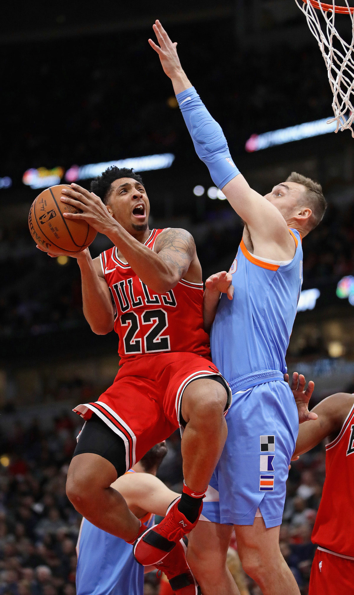 Cameron Payne #22 of the Chicago Bulls goes up for a shot against Sam Dekker #7 of the LA Clippers
