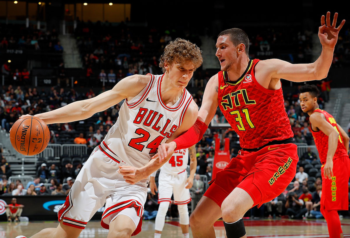 Lauri Markkanen #24 of the Chicago Bulls drives against Mike Muscala #31 of the Atlanta Hawks at Philips Arena on March 11, 2018 in Atlanta, Georgia