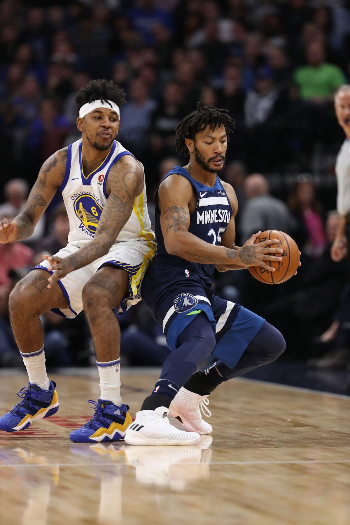 Derrick Rose #25 of the Minnesota Timberwolves handles the ball during the game against the Golden State Warriors on March 11, 2018 at Target Center in Minneapolis, Minnesota