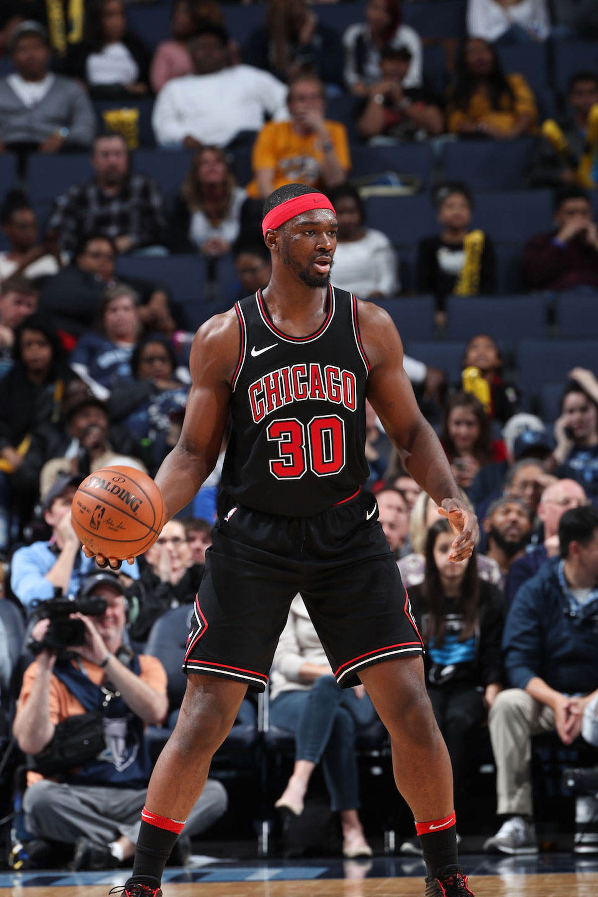 Noah Vonleh #30 of the Chicago Bulls handles the ball during the game against the Memphis Grizzlies