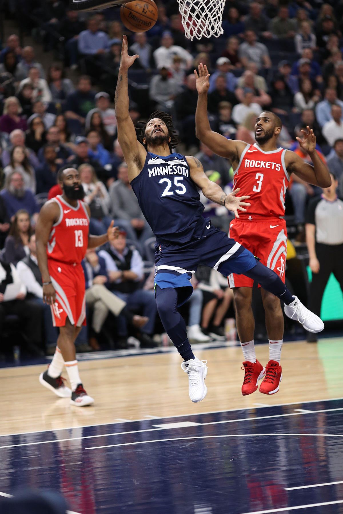Derrick Rose #25 of the Minnesota Timberwolves shoots a lay up against Chris Paul #3 of the Houston Rockets on March 18, 2018 at Target Center in Minneapolis, Minnesota.