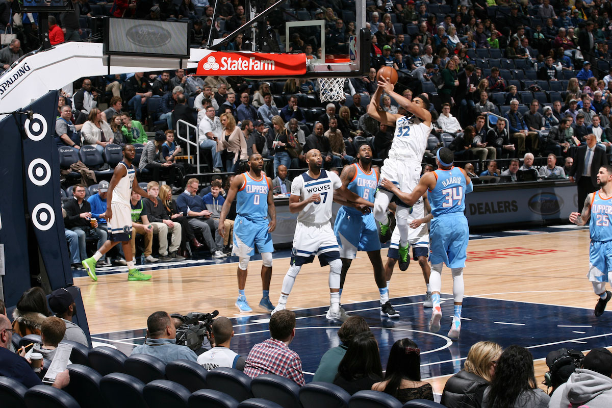 Karl-Anthony Towns #32 of the Minnesota Timberwolves shoots the ball during the game against the LA Clippers on March 20, 2018 at Target Center in Minneapolis, Minnesota.